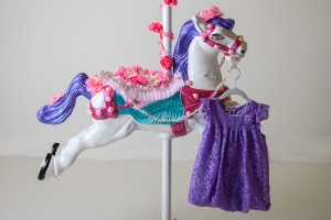Pauline's Photography, Carousel horse and purple lacey dress